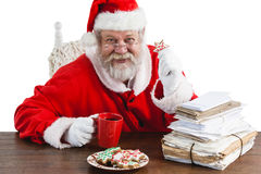 Santa claus having a cup of coffee Royalty Free Stock Image