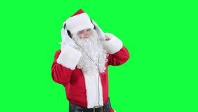 Santa Claus in headphones chroma key (green screen) stock footage