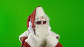 Santa Claus with Headphones and Sunglasses stock video