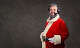 Santa Claus in a headset call center operator. Santa Claus in a headset call center operator on a copyspace background Stock Photography