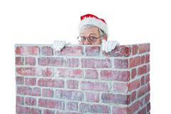 Santa claus hiding behind a chimney. Against white background Stock Images