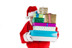 Santa claus hiding behind the gifts Stock Photo