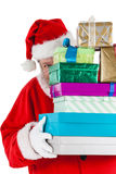 Santa claus hiding behind the gifts Stock Photography