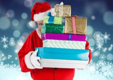 Santa claus hiding behind stack of gifts Royalty Free Stock Photography