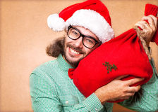 Santa Claus. Hipster Santa Claus with the bag of the presents shows class Stock Images