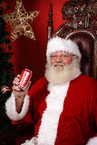 Santa Claus in his chair Stock Images