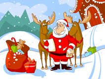 Santa Claus with his deers reads a letter Stock Photo