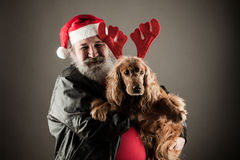 Santa Claus  with his dog  as Rudolph Royalty Free Stock Photos