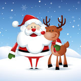 Santa Claus with his friend reindeer in Christmas Stock Photos