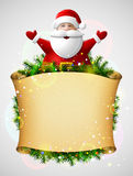 Santa Claus with his hands up above christmas paper scroll Stock Images
