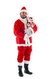 Santa Claus with his little dog Stock Images