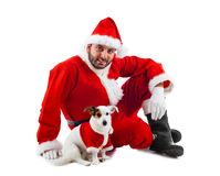 Santa Claus with his little dog Stock Photography