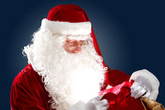 Santa claus with his gift bag Stock Photography