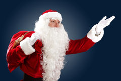 Santa claus with his gift bag Stock Photo