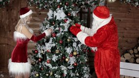 Santa Claus with his niece, I prepare the tree for the winter holidays. Xmas Atmosphere. Christmas and Happy New Year stock footage