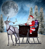 Santa Claus with his reindeer Royalty Free Stock Photography