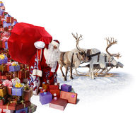 Santa Claus and his reindeer with gifts Stock Image