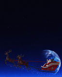 Santa Claus and his Reindeers. Santa Claus is flying in his sleigh and his reindeer in the night the moon is shining Stock Photo