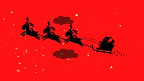 Santa Claus and his reindeers flying in the sky. stock video