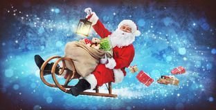 Santa Claus on his sledge. With a bag full of Christmas gifts stock images