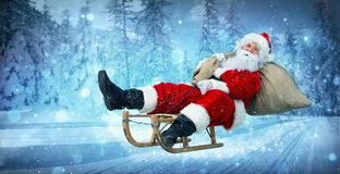 Santa Claus on his sledge. With a bag full of Christmas gifts Stock Photo