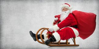 Santa Claus on his sledge. With a bag full of Christmas gifts Royalty Free Stock Photos