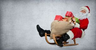 Santa Claus on his sledge. With a bag full of Christmas gifts Royalty Free Stock Photo