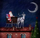 Santa Claus and his sleigh on a roof Stock Photo