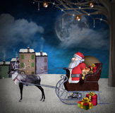Santa Claus and his sleigh in a winter scenery Royalty Free Stock Photo