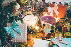 Santa claus hold bell and christmas candle and Ornament decorate Merry Christmas and happy new year. Santa claus hold bell and christmas candle, couple teddy Royalty Free Stock Image