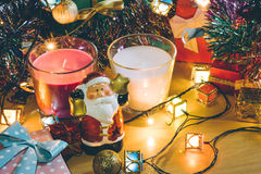 Santa claus hold bell and christmas candle, Ornament decorate Merry Christmas and happy new year. Santa claus hold bell and christmas candle, couple teddy bears Stock Photos
