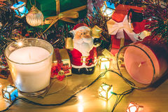 Santa claus hold bell, white and violet christmas candle, Ornament decorate Merry Christmas and happy new year Royalty Free Stock Photo