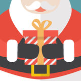 Santa Claus Holding A Christmas Gift Royalty Free Stock Photography