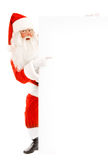 Santa Claus Holding a Advertising Space Stock Photography