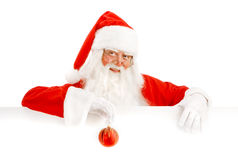 Santa Claus Holding a Advertising Space. Emotional Santa Claus with a Happy Surprise Holding White  Copy Space Royalty Free Stock Images