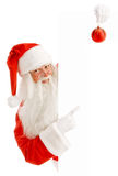 Santa Claus Holding a Advertising Space. Emotional Santa Claus with a Happy Surprise Holding White  Copy Space Royalty Free Stock Photography