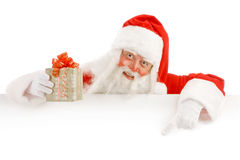 Santa Claus Holding a Advertising Space. Santa Claus Holding a Present Stock Image