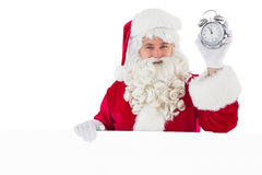 Santa claus holding alarm clock and sign Royalty Free Stock Images