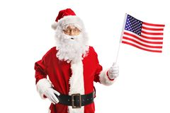 Santa Claus holding an American Flag stock photo