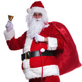 Santa claus holding  bag on shoulder is ringing  bell Royalty Free Stock Images