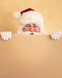 Santa Claus holding banner. Blank. Christmas holiday concept stock photos