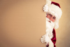 Santa Claus holding banner. Blank. Christmas holiday concept stock images