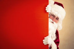 Santa Claus holding banner. Blank. Christmas holiday concept royalty free stock photography