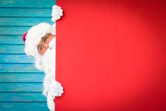 Santa Claus holding banner blank. Merry Christmas greeting card. Xmas holiday concept Stock Photos