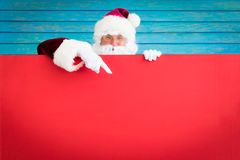 Santa Claus holding banner blank. Merry Christmas greeting card. Xmas holiday concept Royalty Free Stock Image