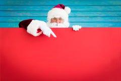 Santa Claus holding banner blank. Merry Christmas greeting card. Xmas holiday concept royalty free stock image