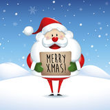 Santa Claus holding banner with Christmas greetings Stock Photography