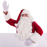 Santa Claus holding Banner. With Space for Your Text . Isolated on white background royalty free stock photos