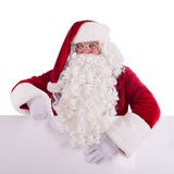 Santa Claus holding Banner. With Space for Your Text . Isolated on white background stock images