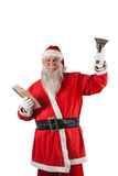 Santa claus holding bible and handle bell. Against white background Stock Image